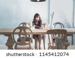 full face of asian lady sitting ... | Shutterstock . vector #1145412074