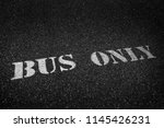 bus only sign painted white on... | Shutterstock . vector #1145426231
