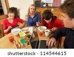 teenage family using gadgets... | Shutterstock . vector #114544615