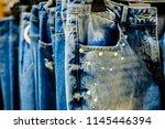 ripped blue denim jeans pants... | Shutterstock . vector #1145446394