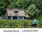 a beautiful small wooden house... | Shutterstock . vector #1145457497