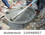 mixing a cement in salver for...   Shutterstock . vector #1145460017