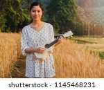 asian woman with ukulele in... | Shutterstock . vector #1145468231