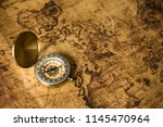 old gold compass on ancient map ... | Shutterstock . vector #1145470964