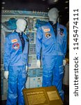 Small photo of Washington DC, USA; 05 24 2014: The blue men women space suits NASA astronauts wore when flying on the space shuttle during ascent and reentry exhibited at the Smithsonian Air and Space Museum.