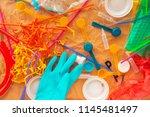 colorful plastic rubbish and... | Shutterstock . vector #1145481497