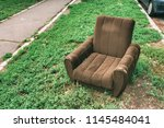 Abandoned Obsolete Armchair On...