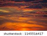 dramatic bright red orange sky... | Shutterstock . vector #1145516417