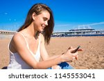 happy smiling woman chatting... | Shutterstock . vector #1145553041