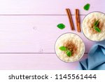 rice pudding with cinnamon and... | Shutterstock . vector #1145561444