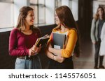 two young women with book... | Shutterstock . vector #1145576051