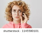 confused and troubled woman... | Shutterstock . vector #1145580101