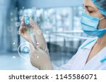 medic gaining the vaccine into... | Shutterstock . vector #1145586071