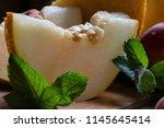 sweet dessert from a cut piece... | Shutterstock . vector #1145645414