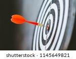 darts hit target. it's like a... | Shutterstock . vector #1145649821