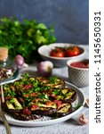 spicy eggplant with tomato... | Shutterstock . vector #1145650331