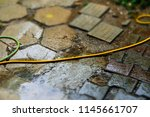 close up rainy puddle with... | Shutterstock . vector #1145661707