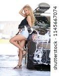 a blonde woman washing a suv car | Shutterstock . vector #1145667074