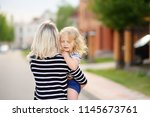 young mother holding her little ... | Shutterstock . vector #1145673761