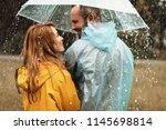 joyful man strolling with woman ... | Shutterstock . vector #1145698814