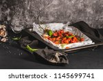 roasted cherry tomotoes.... | Shutterstock . vector #1145699741