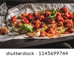 roasted cherry tomotoes.... | Shutterstock . vector #1145699744