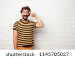 young dumb man looking happy... | Shutterstock . vector #1145705027
