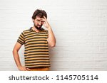 young dumb man looking... | Shutterstock . vector #1145705114