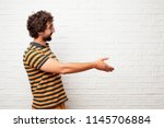 young dumb man with a smiling ...   Shutterstock . vector #1145706884