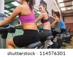 woman looking back on exercise... | Shutterstock . vector #114576301