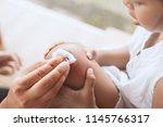 parent helping her child... | Shutterstock . vector #1145766317