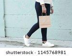 female hands holding shopping... | Shutterstock . vector #1145768981