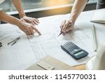 professional architects working ... | Shutterstock . vector #1145770031