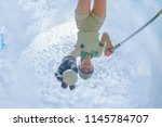 low and bottom view of young... | Shutterstock . vector #1145784707
