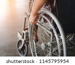 A Disabled Man Is Sitting In A...