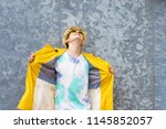 young with raincoat and glasses ... | Shutterstock . vector #1145852057