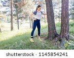 woman doing exercises in a park | Shutterstock . vector #1145854241