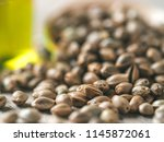 close up view of hemp seeds and ... | Shutterstock . vector #1145872061
