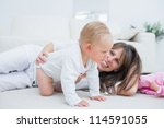 baby on all fours next to his... | Shutterstock . vector #114591055