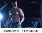 young strong athlete trains.... | Shutterstock . vector #1145930831