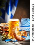 beer mugs and pretzels on a... | Shutterstock . vector #1145935691
