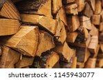 stacks of firewood.... | Shutterstock . vector #1145943077