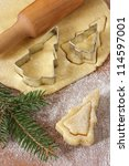 Christmas baking background dough, cookie cutters, rolling pin. - stock photo
