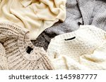 bunch of knitted warm pastel... | Shutterstock . vector #1145987777