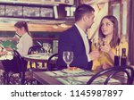 lovely couple is dining... | Shutterstock . vector #1145987897