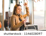 woman standing in train  tram... | Shutterstock . vector #1146028097