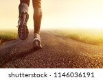 jogging on dirt road | Shutterstock . vector #1146036191