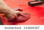 butcher cutting meat | Shutterstock . vector #114604207