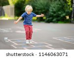 child playing hopscotch on... | Shutterstock . vector #1146063071