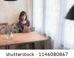 lovely lady sitting on a chair... | Shutterstock . vector #1146080867